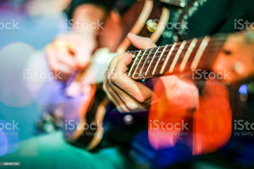 Playing electric guitar in concert stock photo