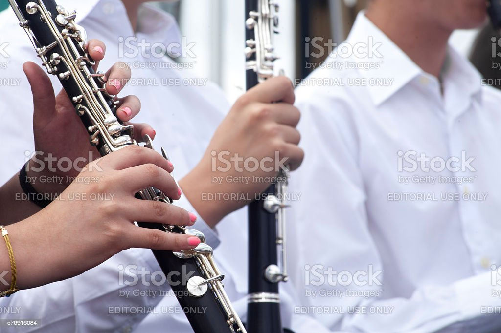 Playing flute in an open air concert. stock photo