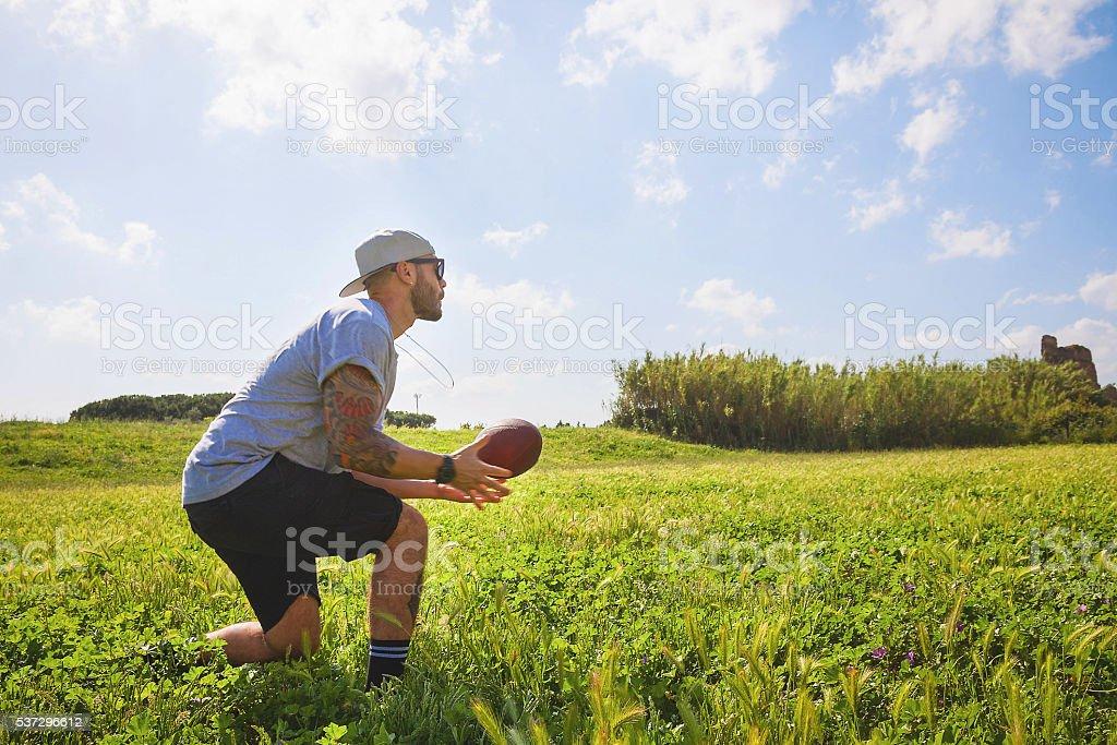 Playing football at park stock photo