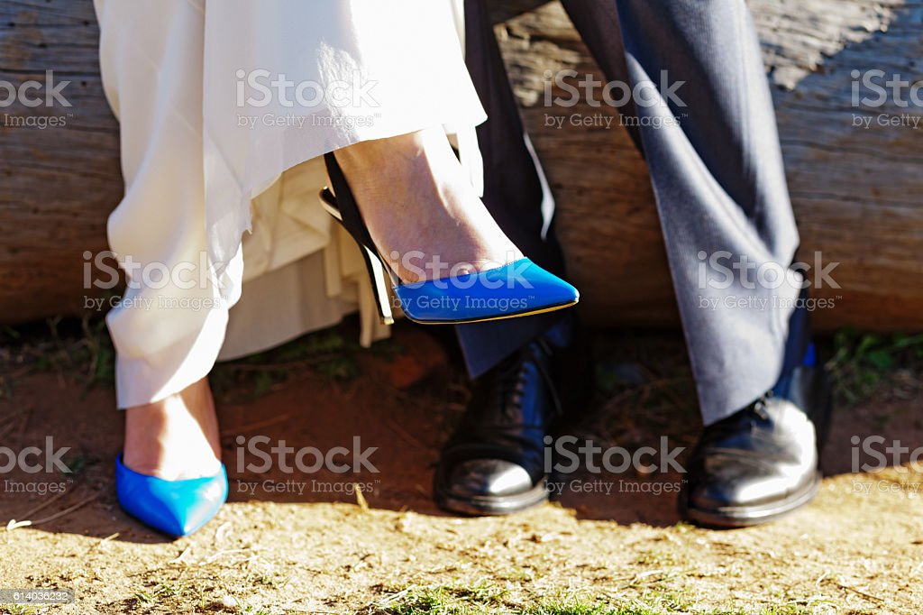 Playing footsie! Feet of a couple in formal clothes stock photo
