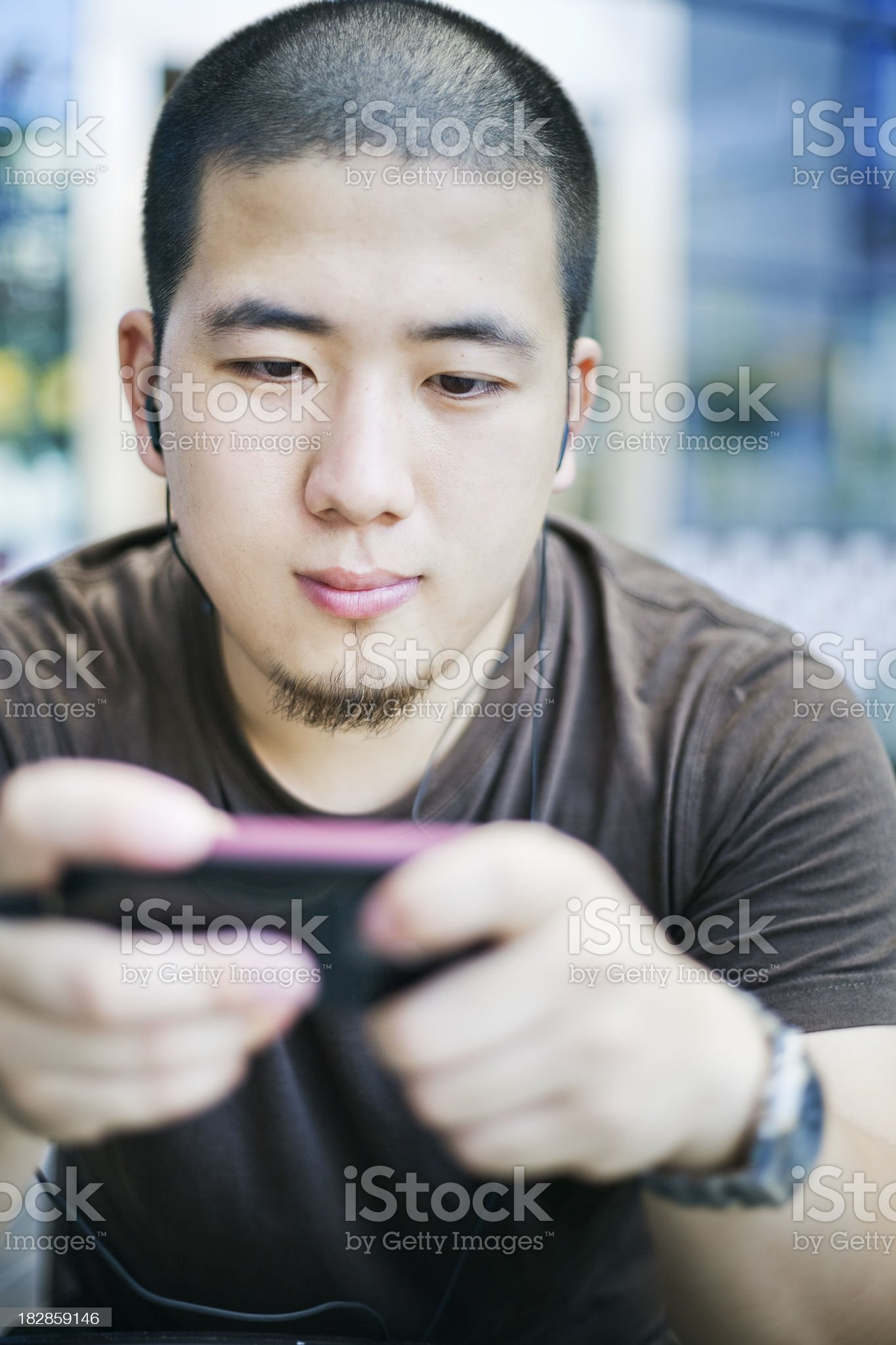 Playing games with a cellphone royalty-free stock photo