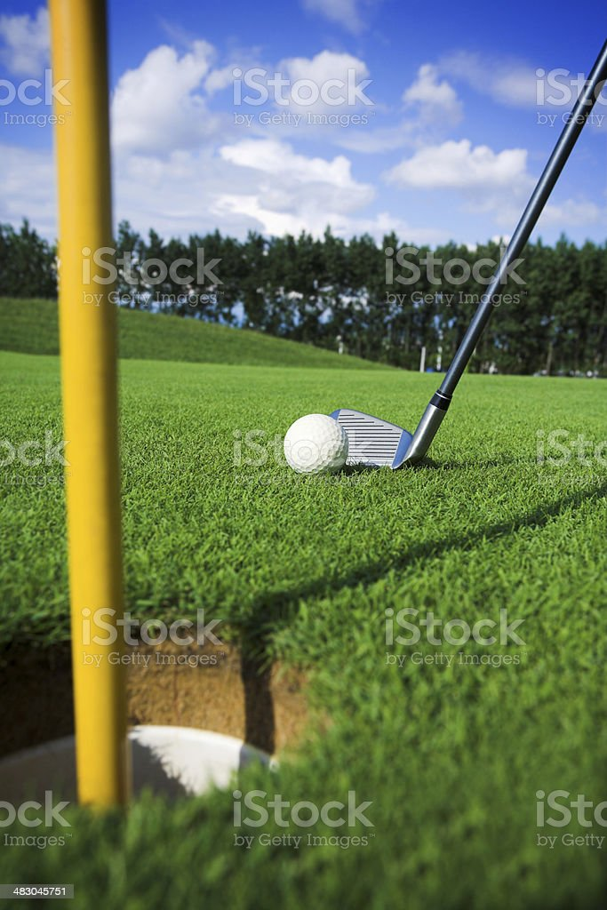 playing golf. Ball is near hole royalty-free stock photo
