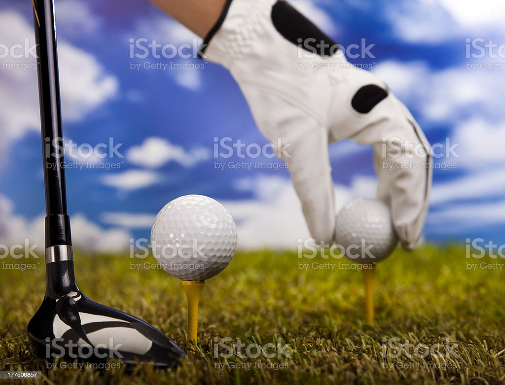 Playing golf, ball on tee royalty-free stock photo