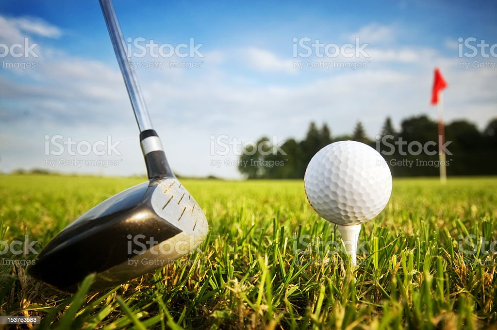 Playing golf. Club and ball on tee stock photo
