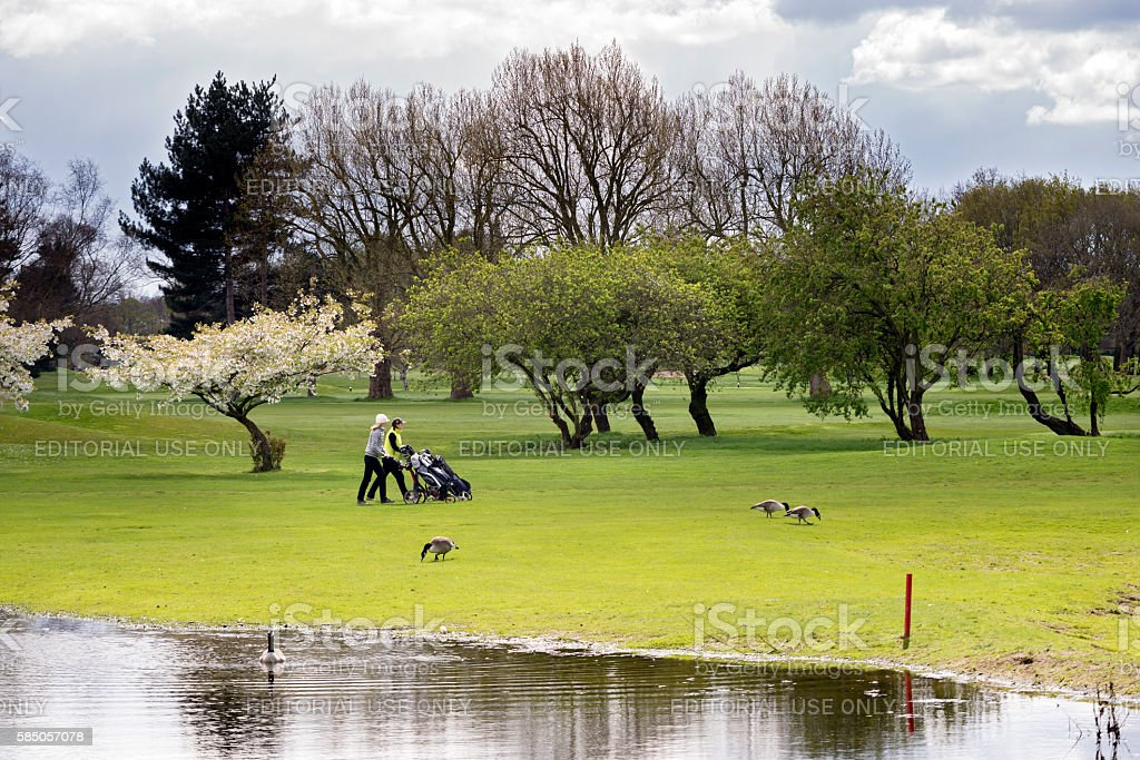 Playing golf in springtime in London England stock photo