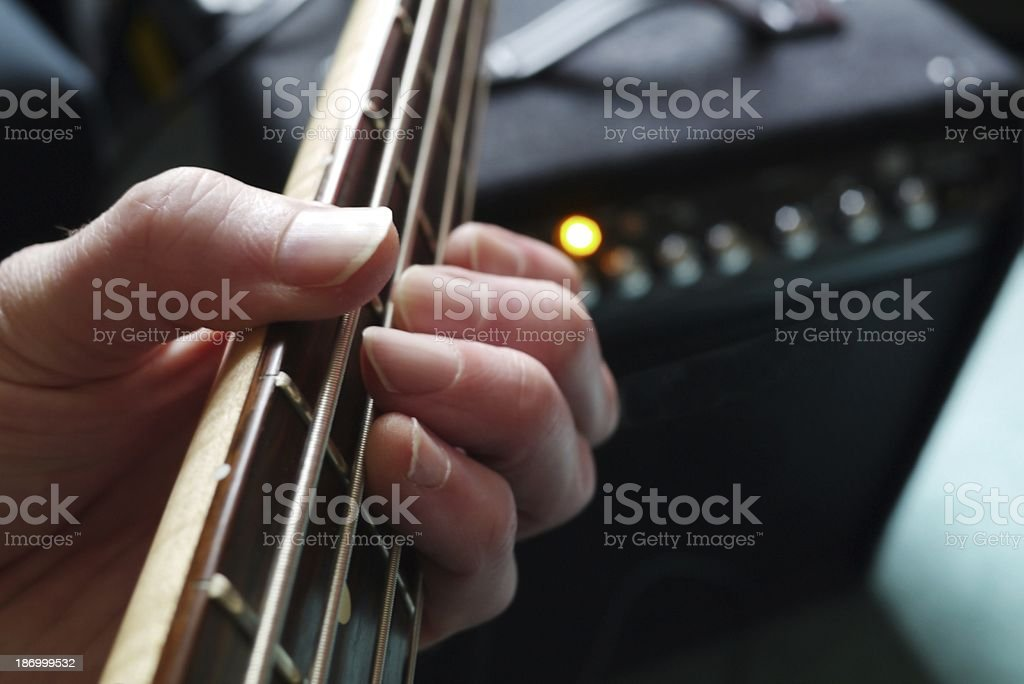 Playing guitar amplifier and fretboard with strings. stock photo