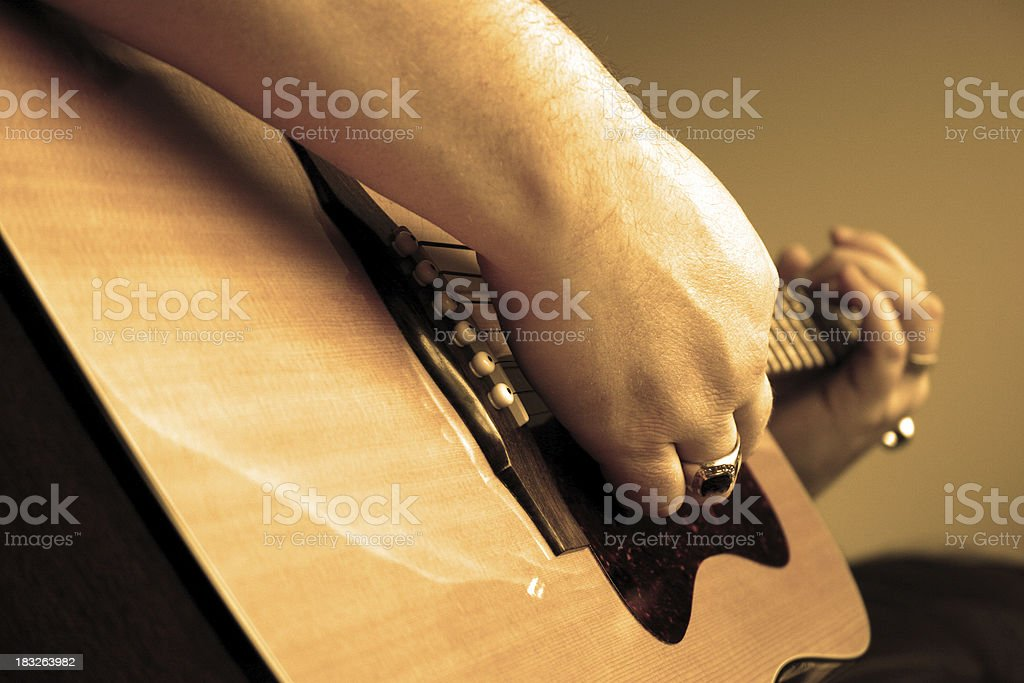 Playing Guitar Close-up - sepia stock photo
