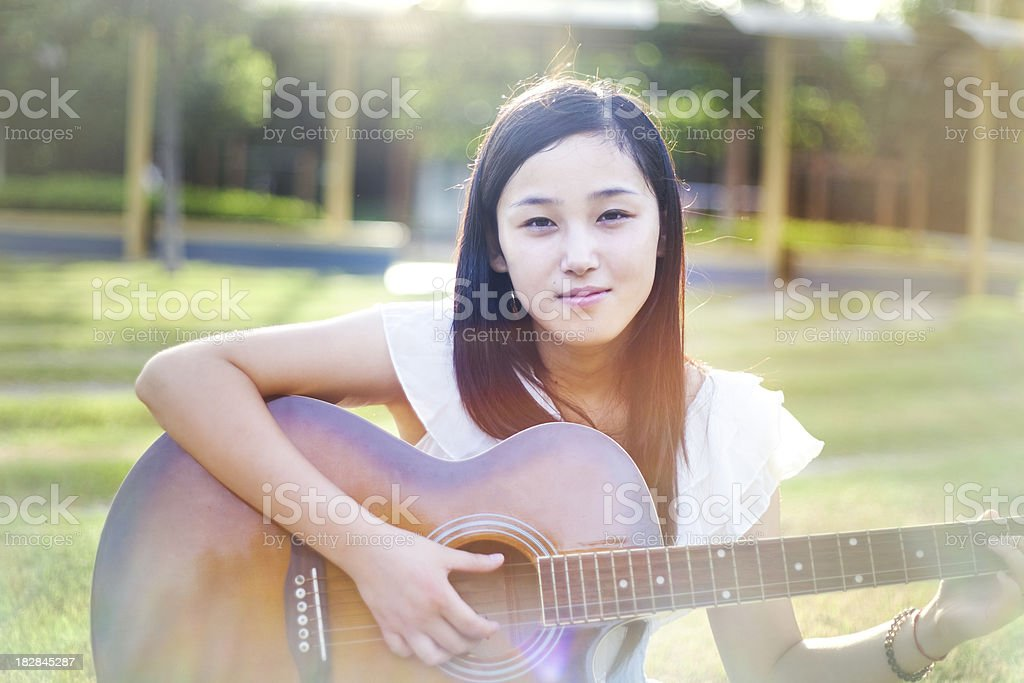 Playing Guitar in park royalty-free stock photo
