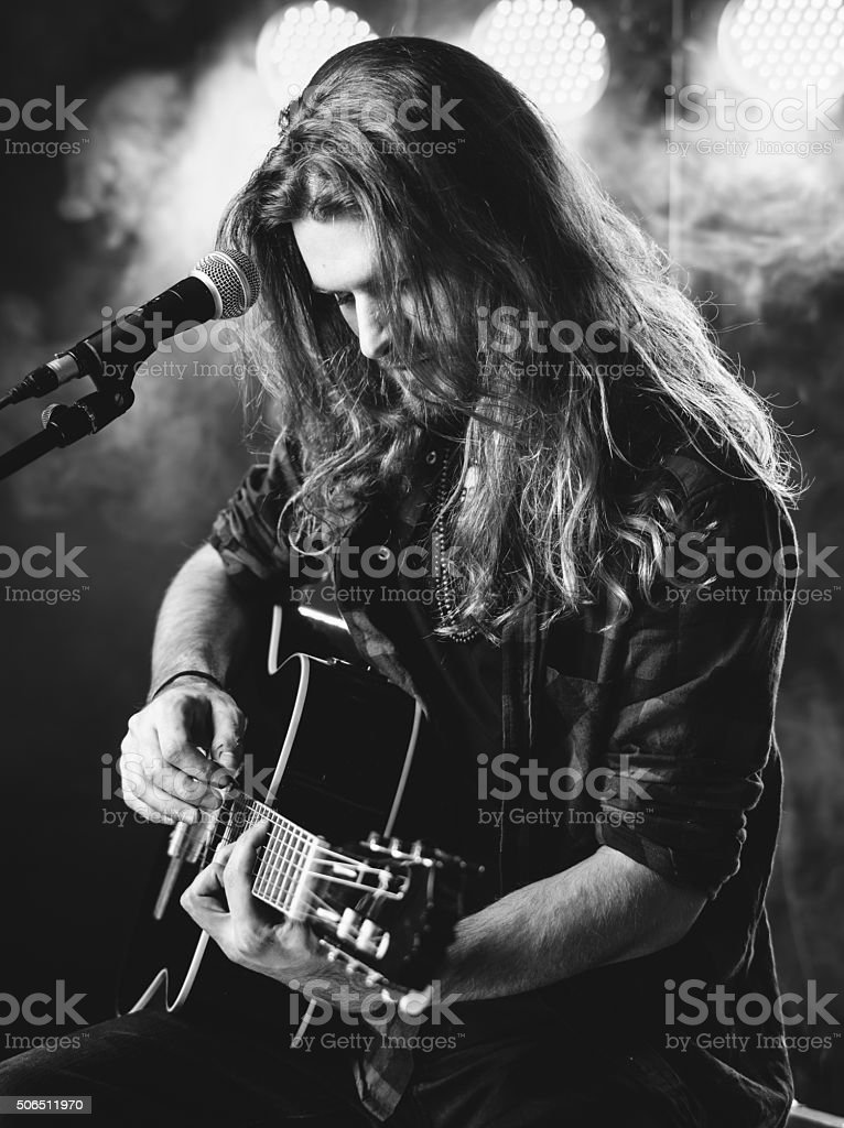 Playing guitar on stage stock photo