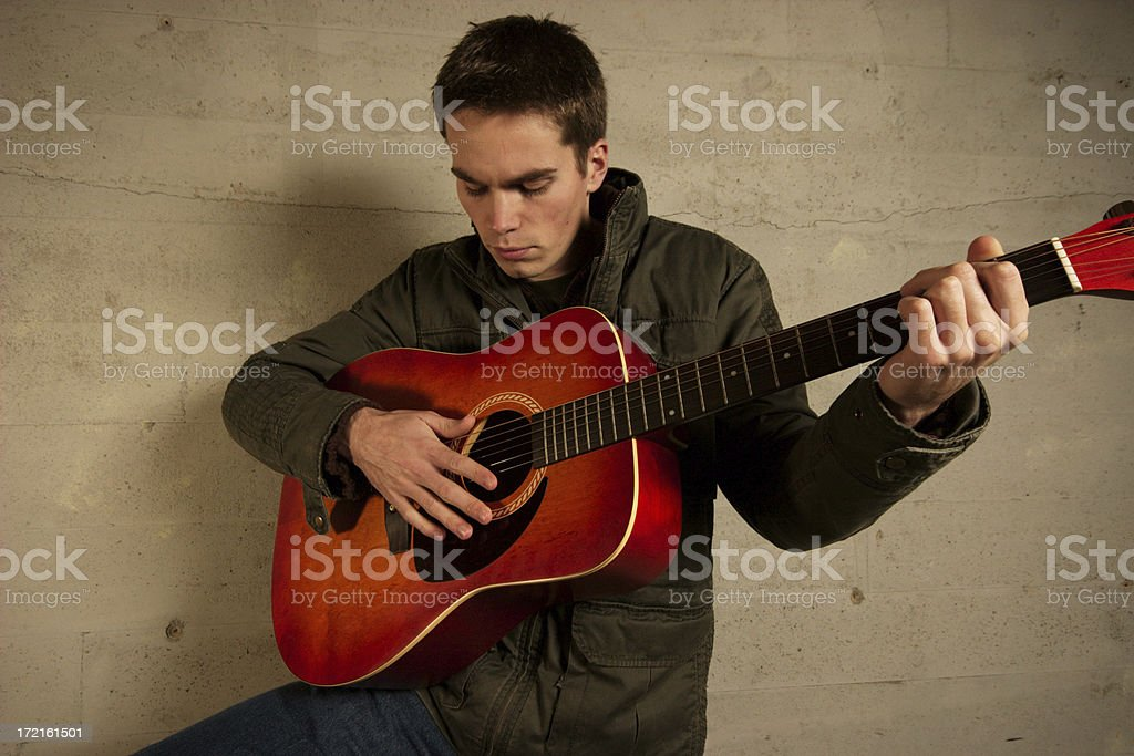 Playing guitar royalty-free stock photo