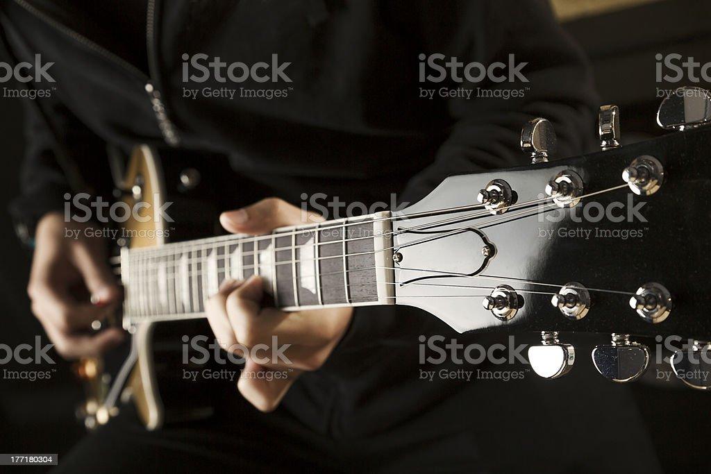Playing guitar royalty-free stock photo