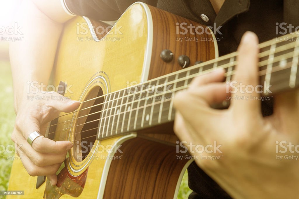 playing guitar with sunlight filter stock photo