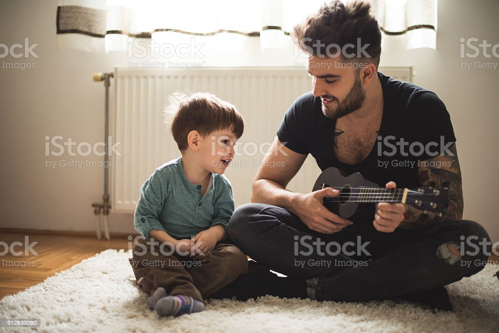 Playing his favorite song stock photo