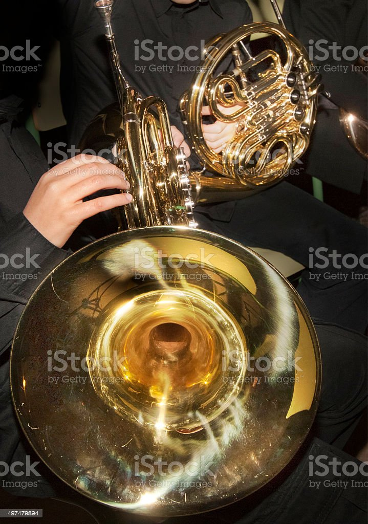 Playing horn, horn bell in the foreground. stock photo