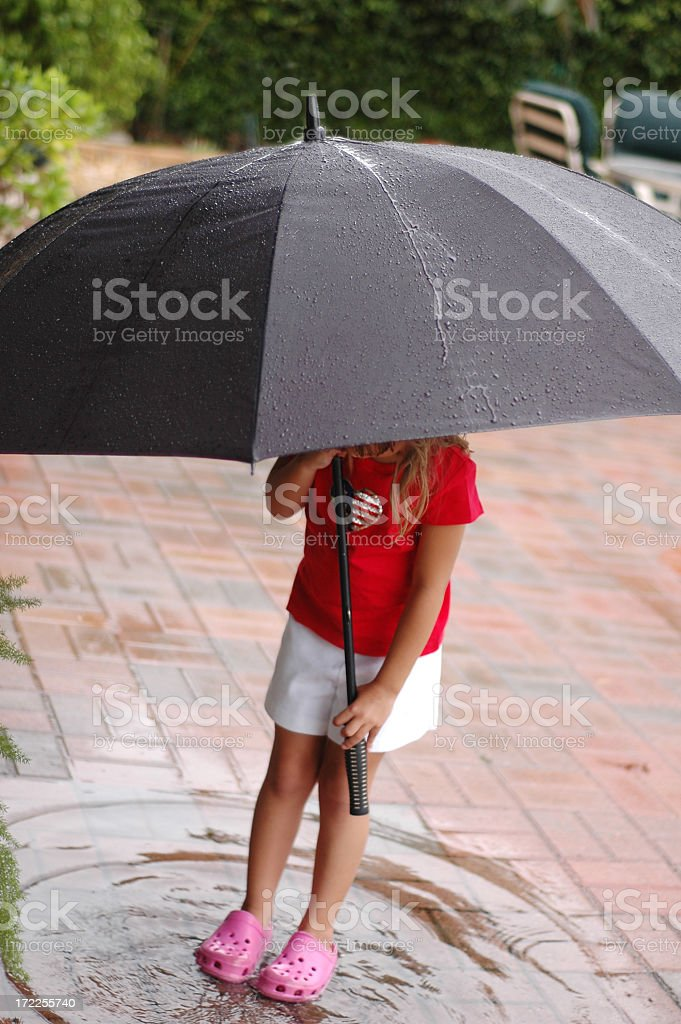 Playing in a puddle royalty-free stock photo