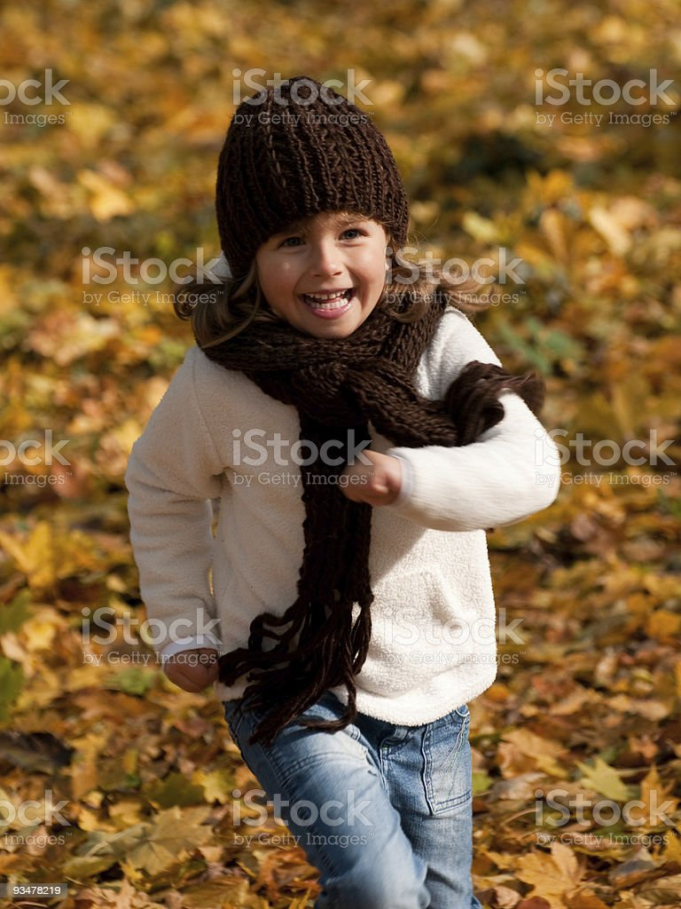 Playing in autumn park royalty-free stock photo