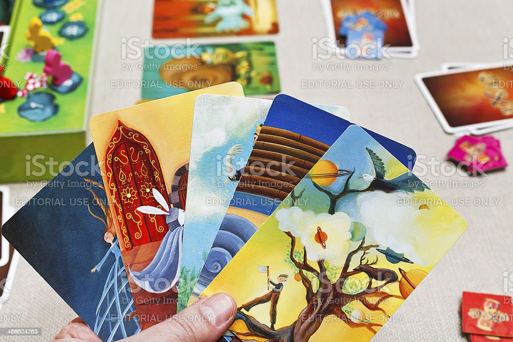 playing in Dixit card game stock photo
