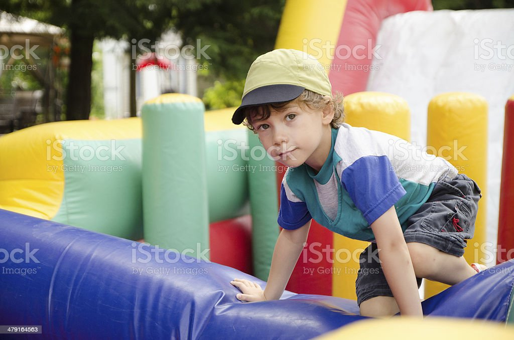 Playing in Inflatable playground stock photo