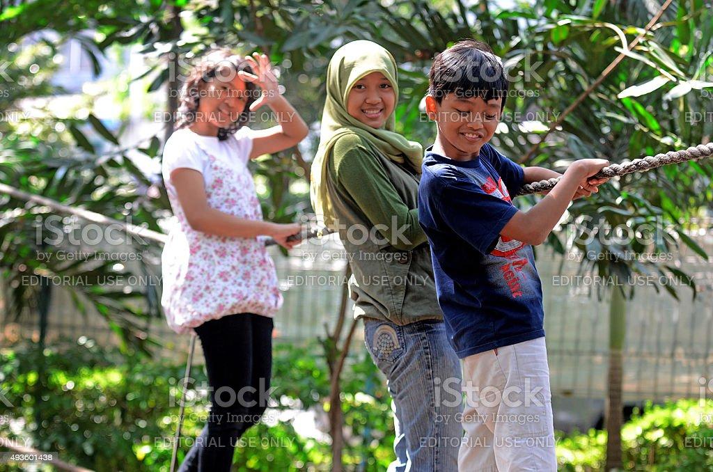 Playing in Kebun Bibit Surabaya stock photo