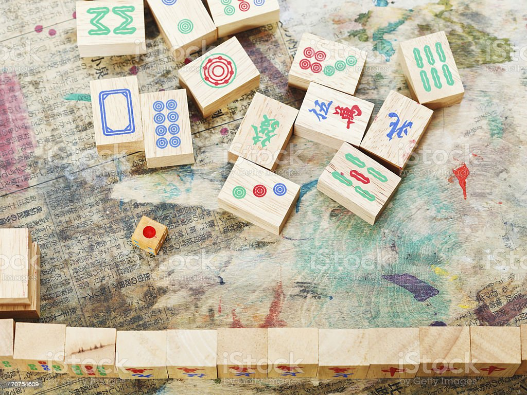 playing in mahjong game by wood tiles stock photo