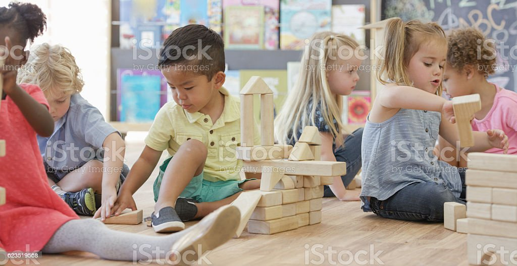 Playing in Preschool Together stock photo