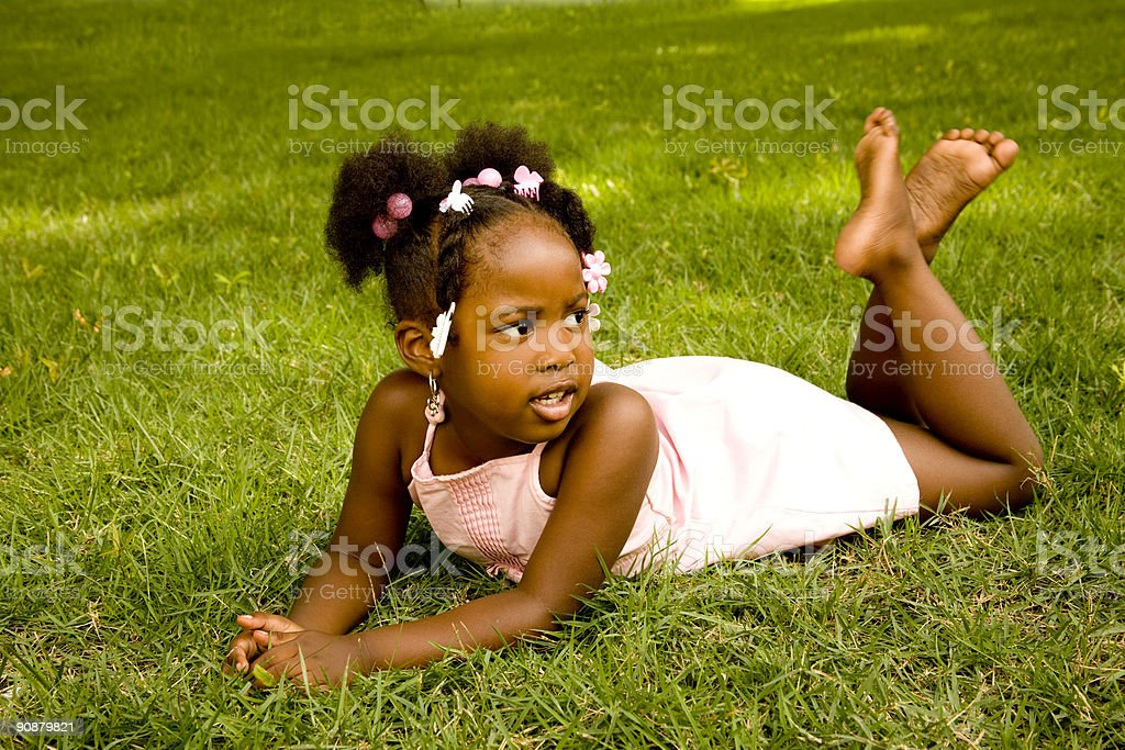 Playing in the grass royalty-free stock photo