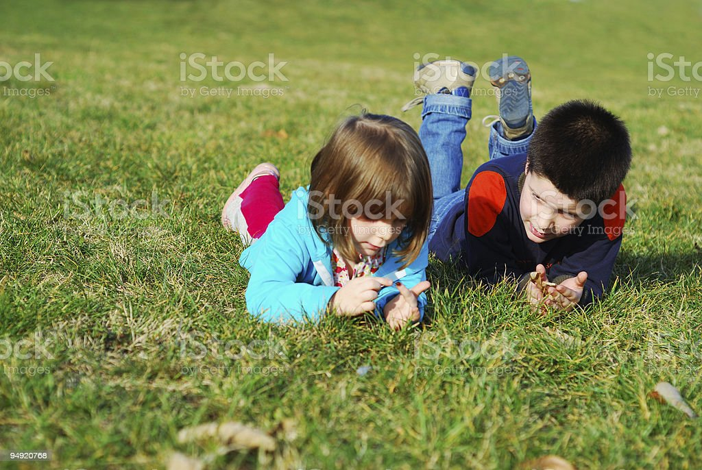 Playing in the grass stock photo