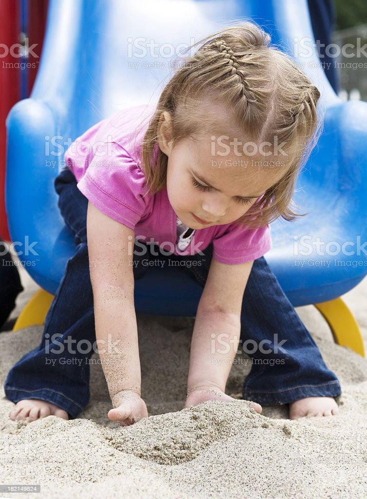 Playing in the sand royalty-free stock photo