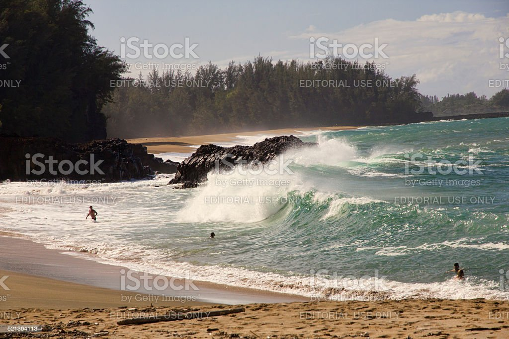Playing in the Surf - Lumahai Beach on Kauai, Hawaii stock photo