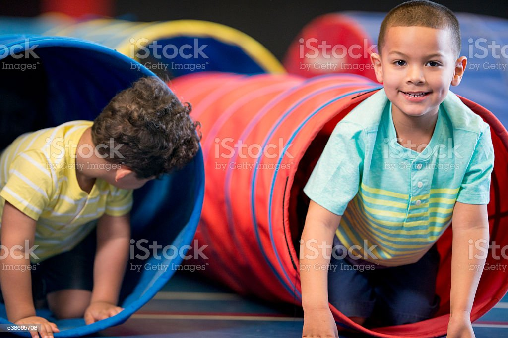 Playing in Toy Tunnels stock photo