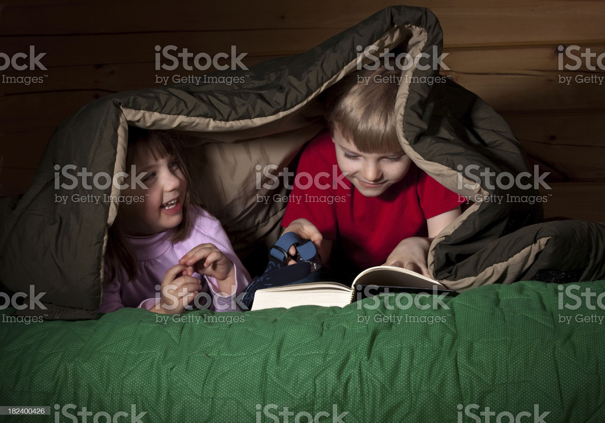 Playing late at night under the sleeping bag royalty-free stock photo