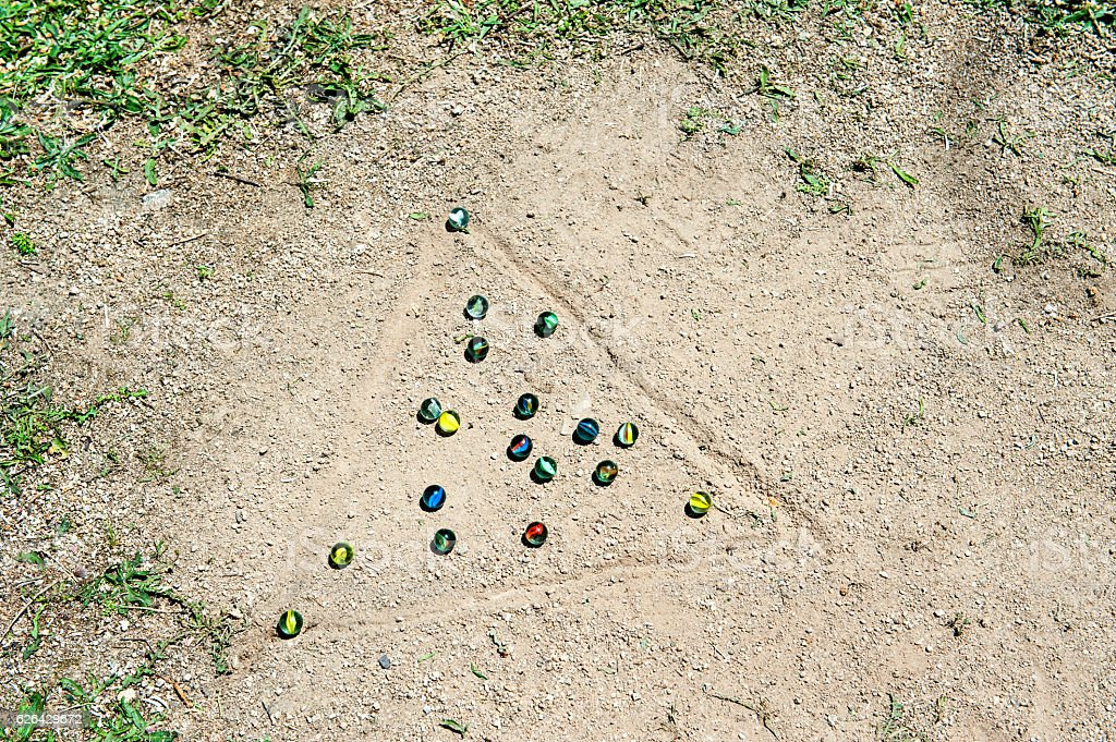 Playing Marbles triangle stock photo