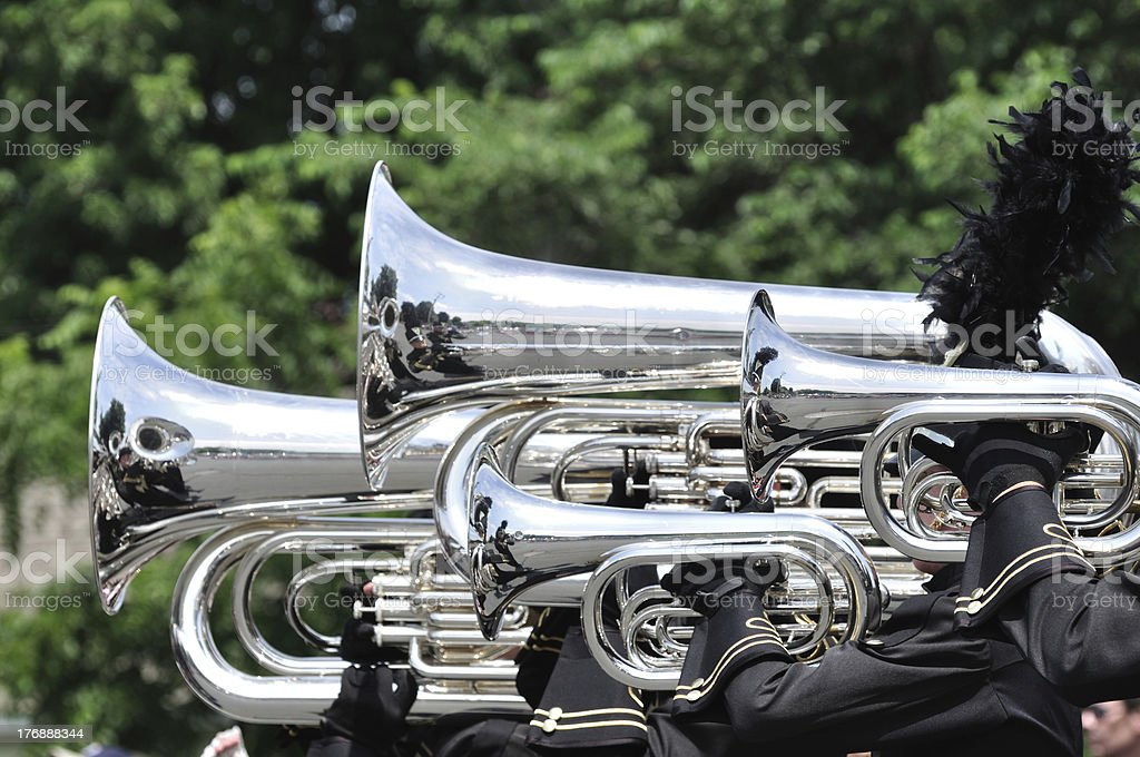 Playing Marching Tubas and Baritones in Parade stock photo