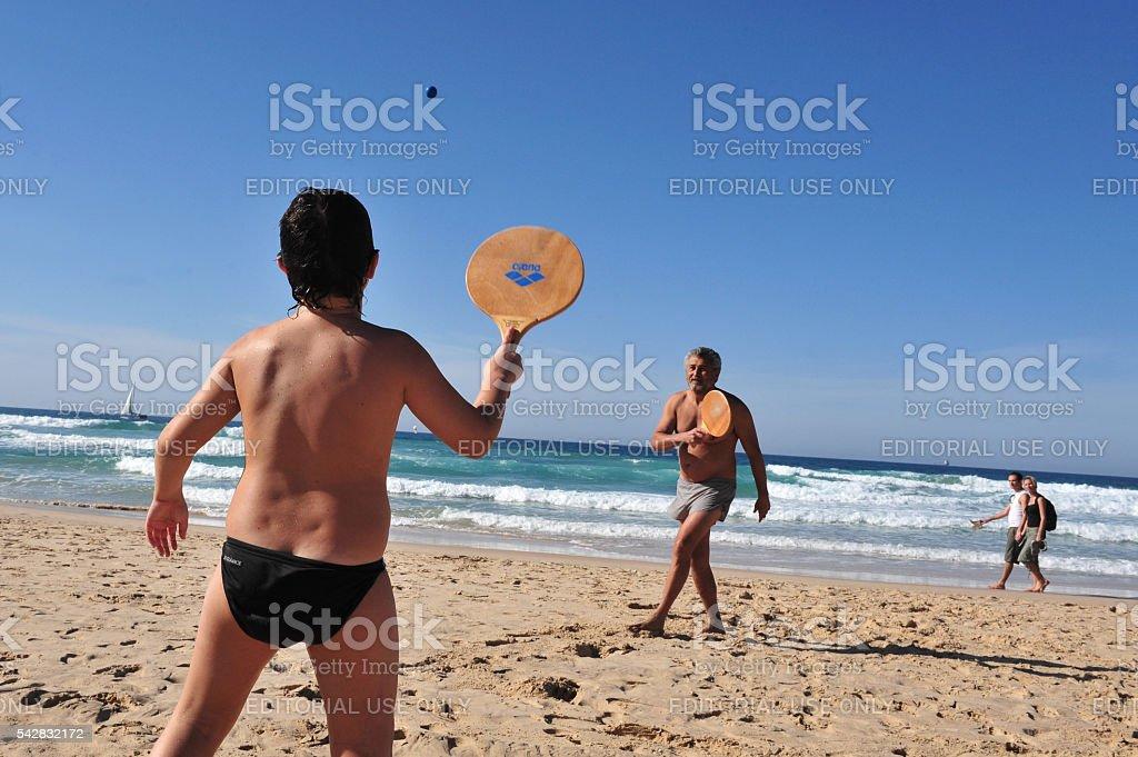 Playing Matkot on Ashdod Beach - Israel stock photo