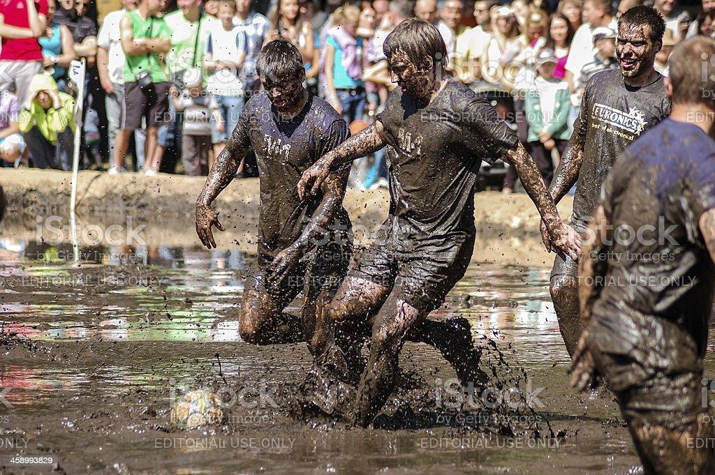 Playing mud football stock photo