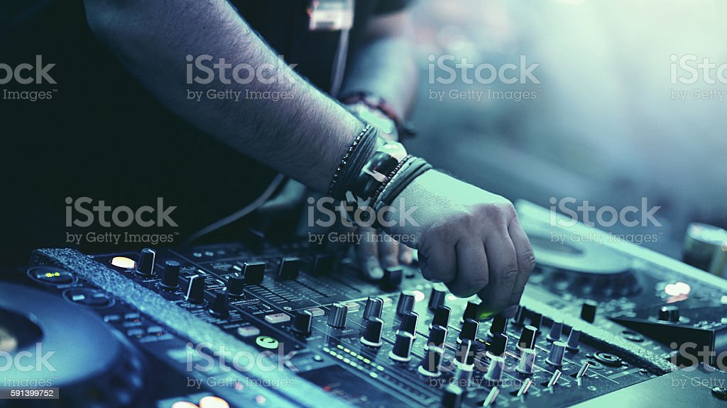 DJ playing music at a party. stock photo