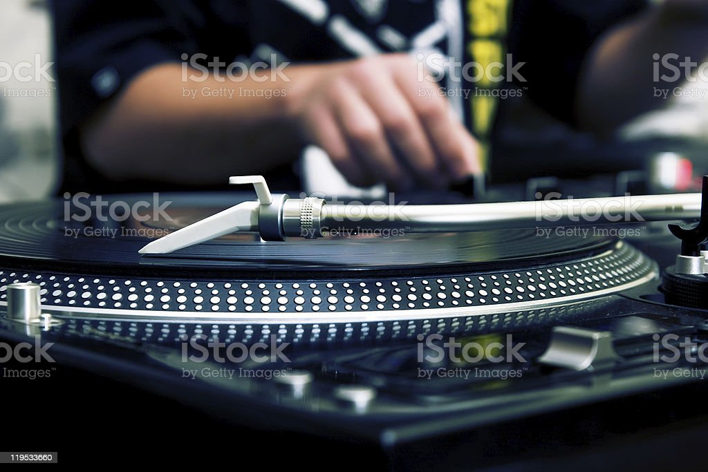DJ playing music from vinyl record stock photo