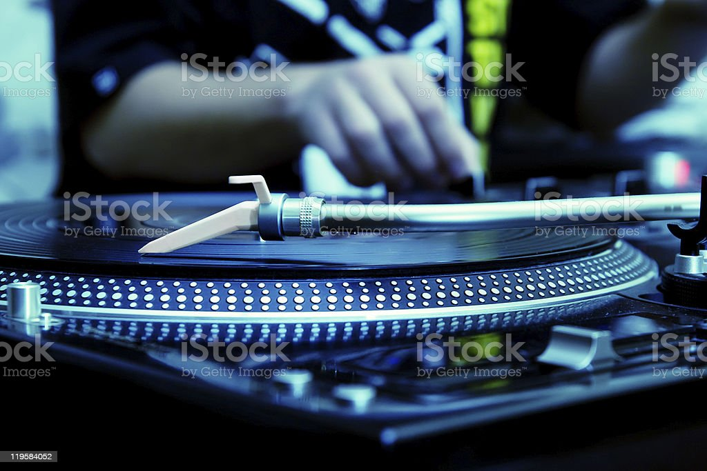 DJ playing music from vinyl record royalty-free stock photo