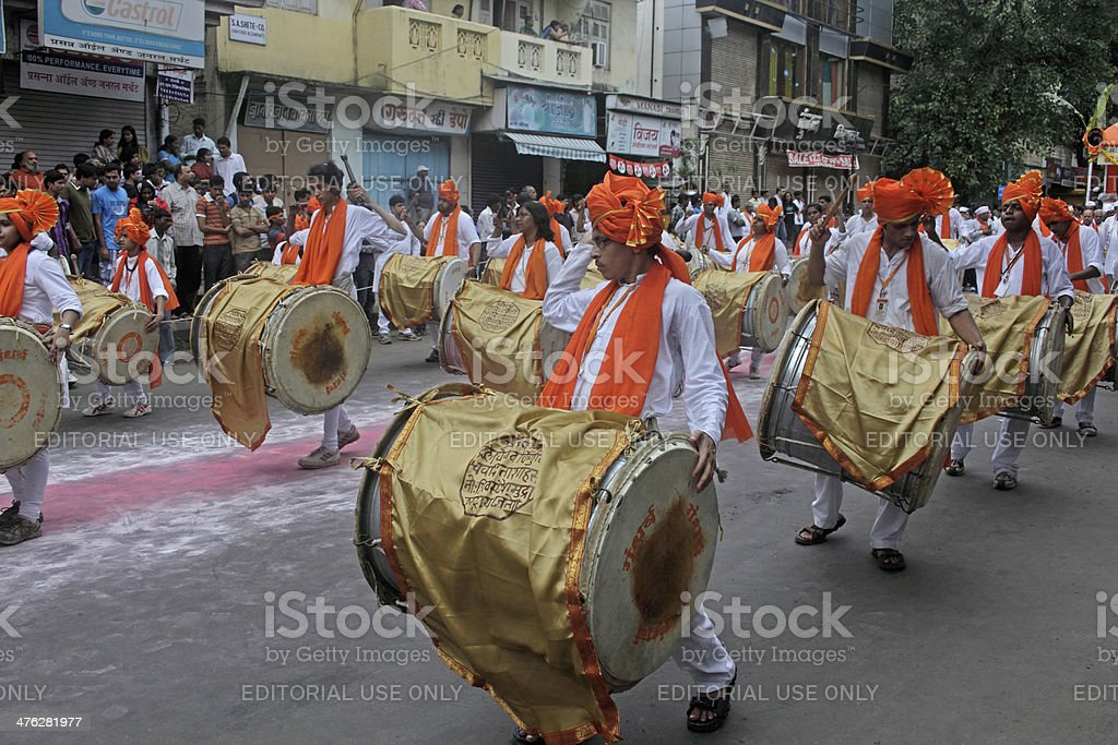 playing musical instrument called 'dhol-taasha' big drum royalty-free stock photo