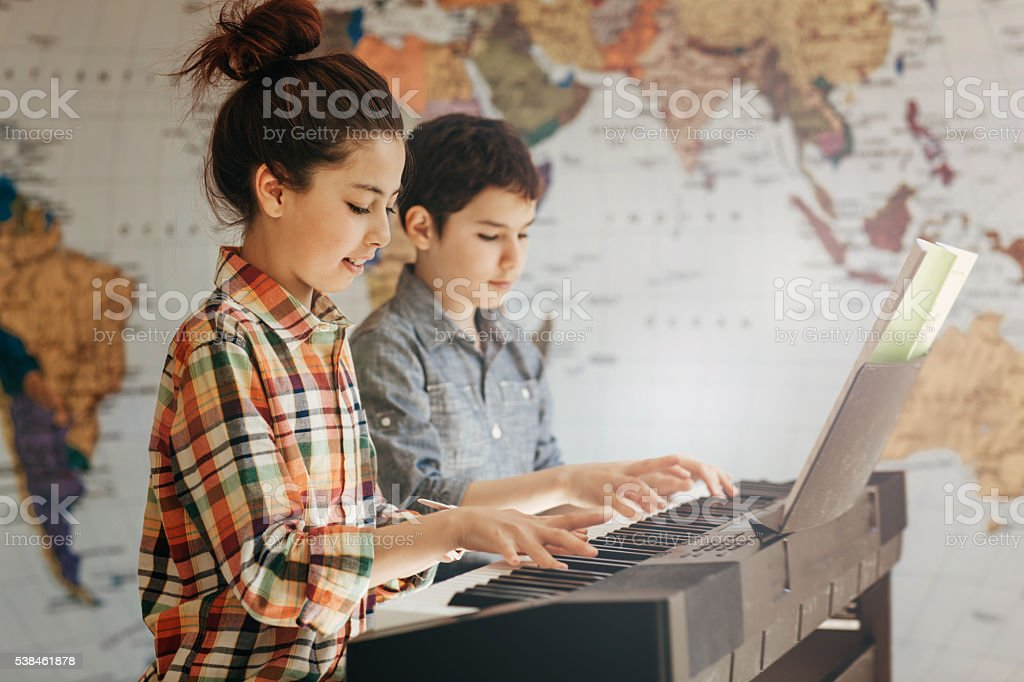 Playing new composition together stock photo