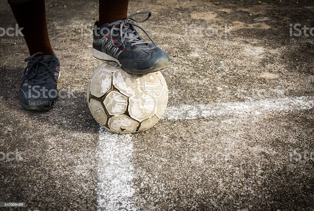 Playing old football on concrete field stock photo