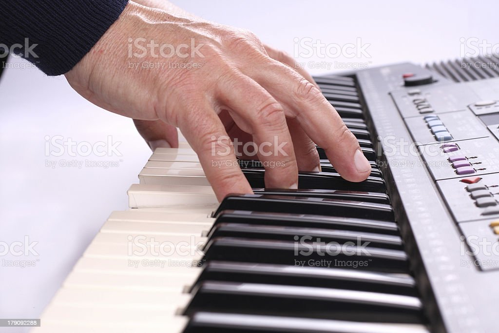 Playing on a Keyboard royalty-free stock photo