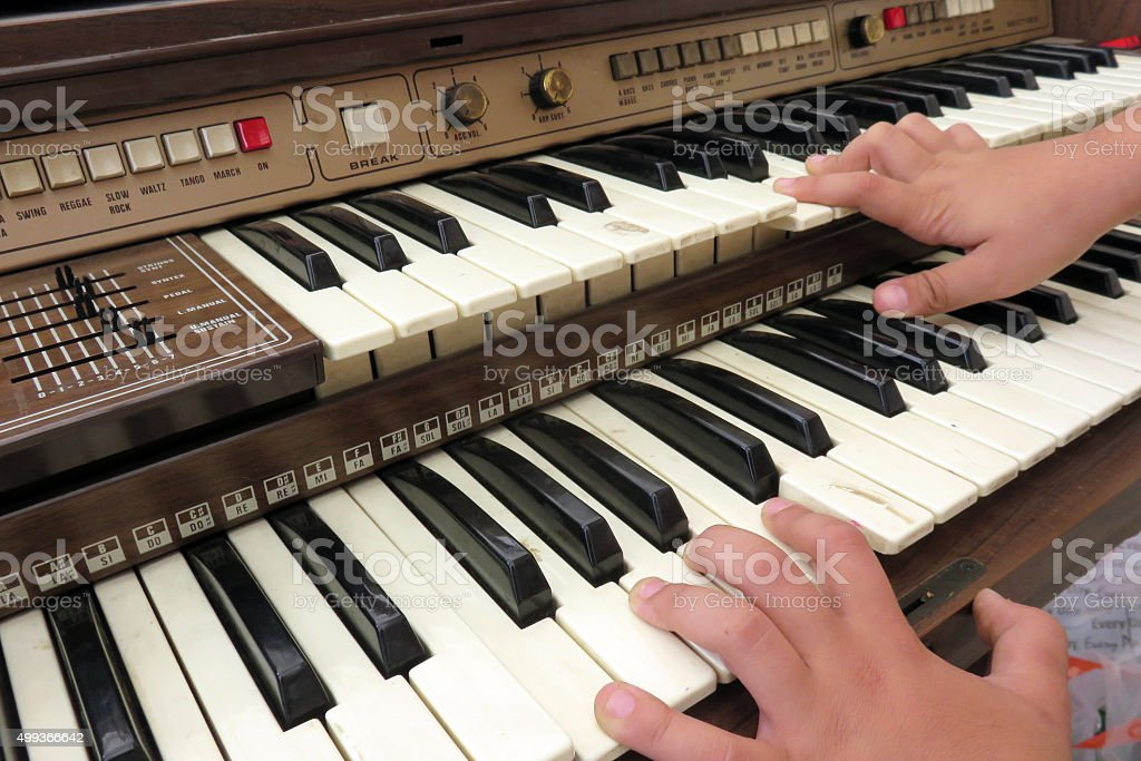 Playing on a keyboards stock photo