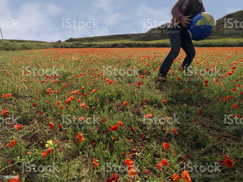 Playing on a poppies field stock photo