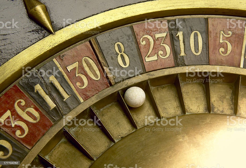 Playing on a vintage roulette royalty-free stock photo