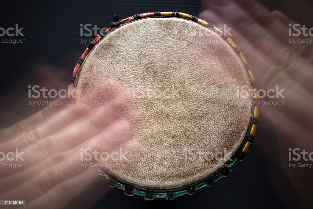 Playing on djembe - Top View stock photo