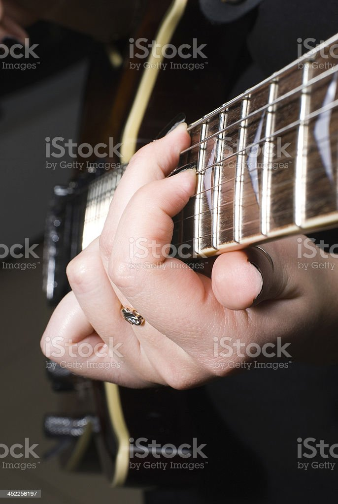 Playing on guitar royalty-free stock photo