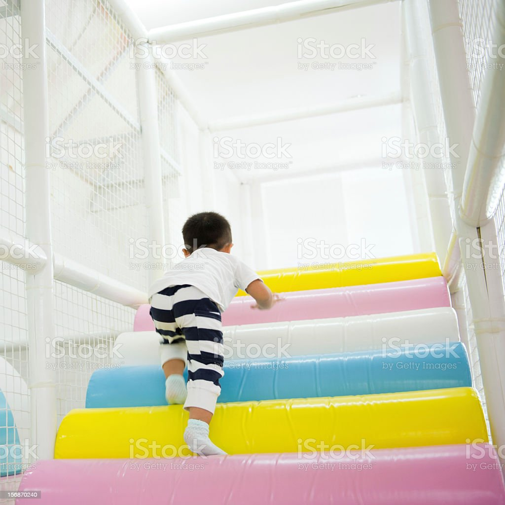 playing on obstacle course stock photo