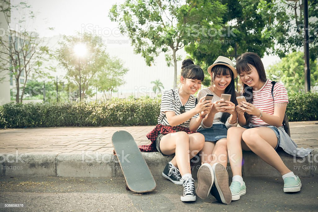 Playing on smartphones stock photo