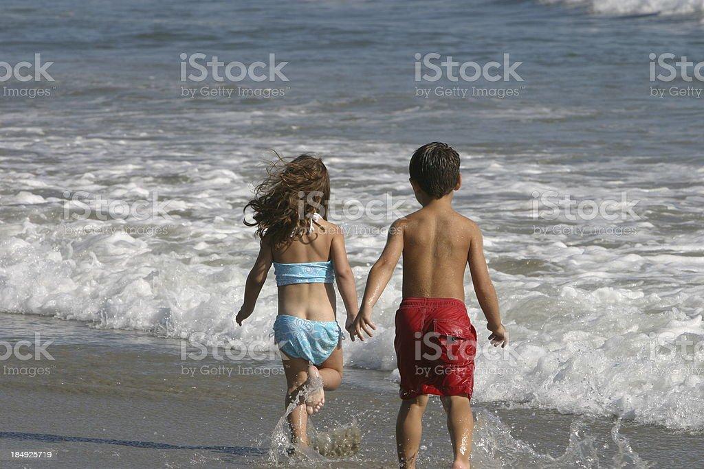 Gioca sulla spiaggia foto stock royalty-free